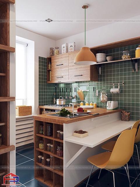 Mẫu bàn ăn cho nhà bếp nhỏ được thiết kế thông minh như một chiếc bàn đảo bếp gắn kết với bộ tủ bếp để gia đình có thể thưởng thức bữa ăn ngon một cách tiện lợi nhất