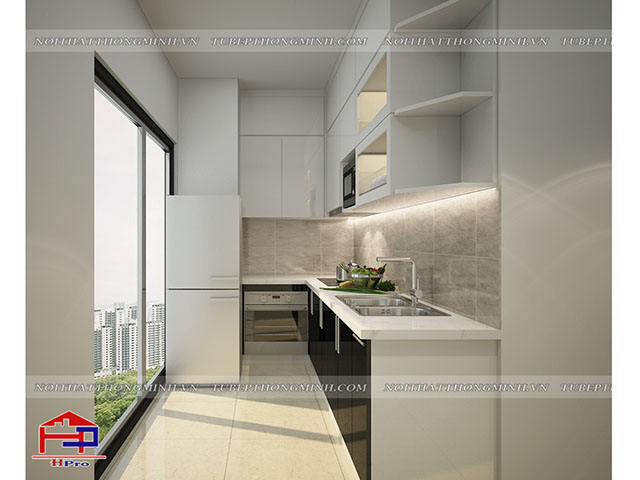 Mẫu tủ bếp cho phòng bếp nhỏ theo kiểu dáng chữ L được làm bằng chất liệu gỗ acrylic bóng gương An Cường với bề mặt bóng gương thu hút mang lại cảm giác không gian nhưu rộng hơn rất nhiều so với kích thước thực tế