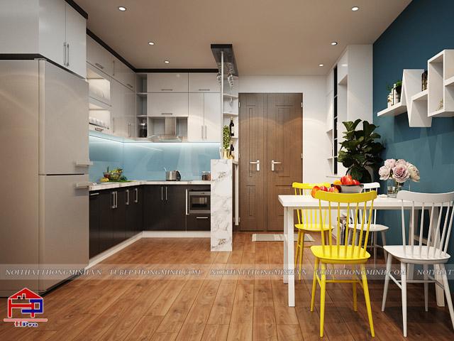 Tủ bếp đẹp cho phòng bếp nhỏ bằng chất liệu gỗ acrylic bóng gương An Cường màu đen - trắng được thiết kế kèm quầy bar mini tiện lợi giúp gia đình có thể thư giãn và tận hưởng những giây phút thoải mái nhất trong chính căn bếp của mình