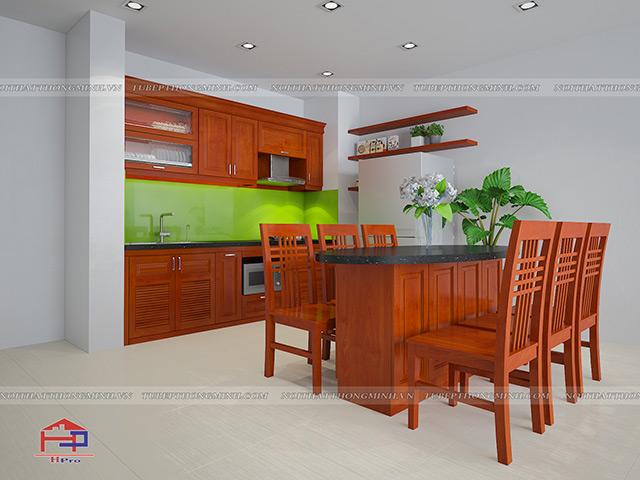 Mẫu nhà bếp hình vuông được thiết kế từ chất liệu gỗ xoan đào tự nhiên màu cánh gián sang trọng. Thiết kế tủ bếp và bộ bàn ăn với những chi tiết đơn giản nhưng vẫn đáp ứng công năng sử dụng cao của người nội trợ